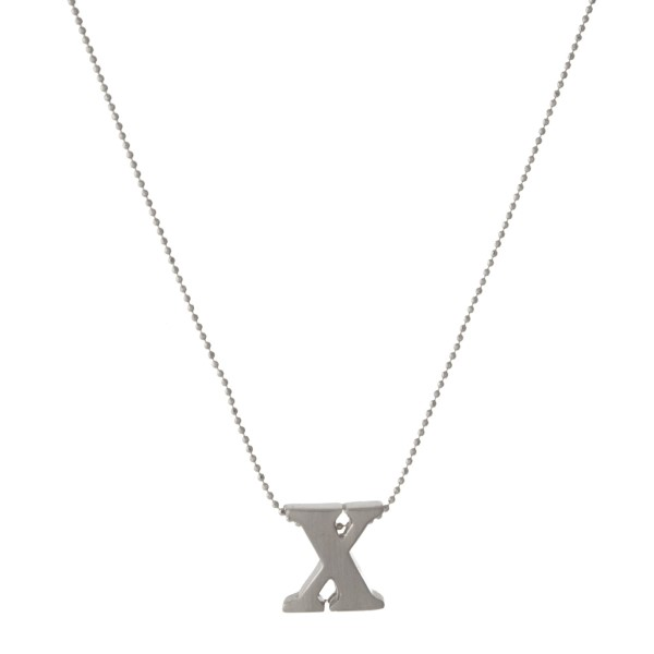 "16"" small silver tone chain necklace with a 1/2"" silver tone ""x"" initial. Comes on a card with the inscription reading ""Wherever you are, whatever you do, whoever you are with, keep it close to your heart."""