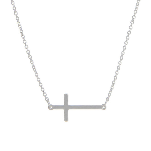 """Matte silver tone chain necklace with a 1"""" horizontal cross pendant. Approximate 16"""" in length."""