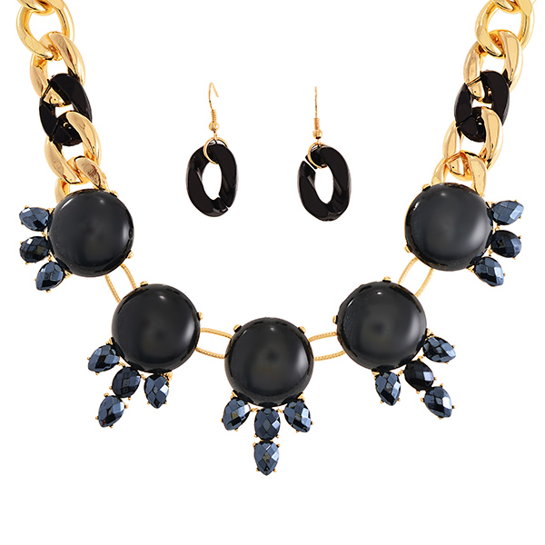"16"" Gold tone thick chain link shourouk necklace with a black tone chain link accent featuring a metallic black acrylic stone focal accented by faceted AB black acrylic cabochons and matching 1 3/4"" black tone link fishhook earrings."