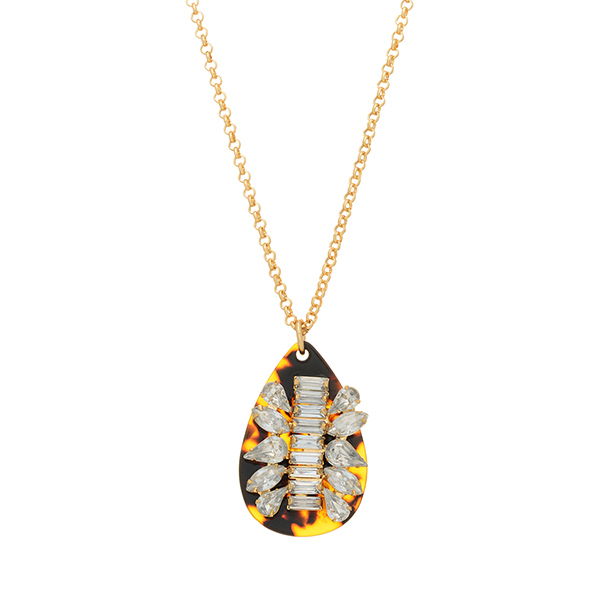 "Gold tone necklace featuring a tortoise teardrop shaped pendant with crystal clear rhinestone decor. Approximately 20"" in length."