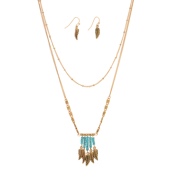 """Burnished gold tone layering necklace set featuring turquoise beaded fringe with hanging leaves. Approximately 18"""" in length."""