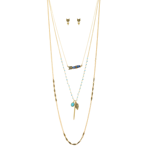 """Gold tone layering necklace set featuring blue beads, an arrow with a wire wrapped royal blue natural stone, an arrowhead and stick charm, and a light blue cabochon. Approximately 31"""" in length."""