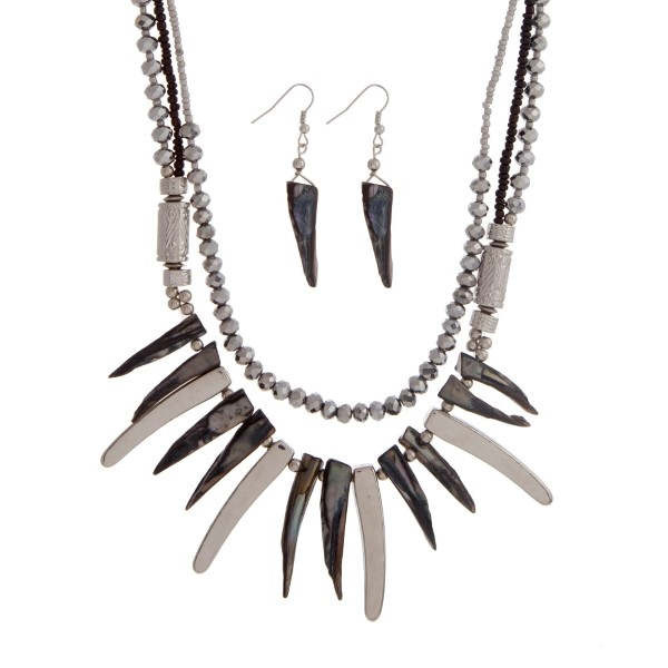 """Black and silver beaded layering necklace set with two silver tone decorative bead stations and black and silver pointed bars. Approximately 18"""" in length."""