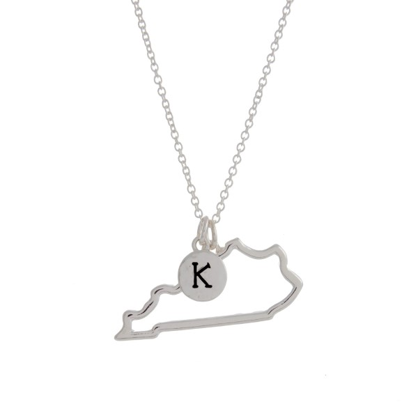 "Silver tone necklace with a cutout state of Kentucky pendant and a ""K"" charm. Approximately 18"" in length."