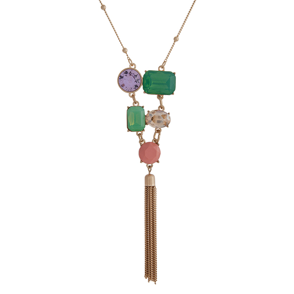 "Gold tone necklace displaying multiple shaped mint, champagne, pink, and clear cabochons with a 2 1/4"" chain tassel. Approximately 29"" in length. Overall length 33 1/4""."