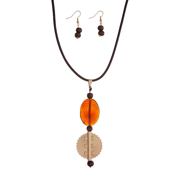 """Brown leather cord necklace set displaying an orange stone with a gold tone decorative disk. Approximately 14"""" in length."""