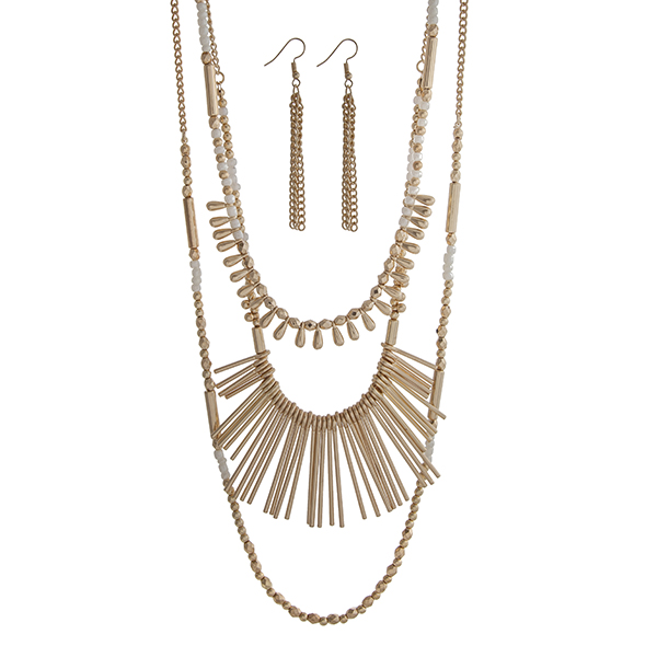 """Gold tone layering necklace set displaying white and gold beads and metal fringe. Approximately 33"""" in length."""