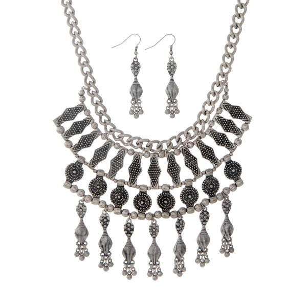 """Silver tone bohemian inspired necklace set with dangling charms. Approximately 19"""" in length."""