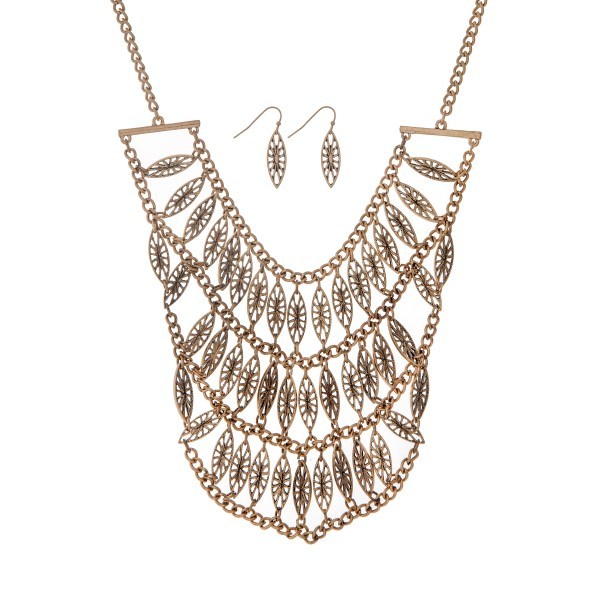 """Burnished gold tone necklace set displaying rows of bohemian style charms. Approximately 17"""" in length."""