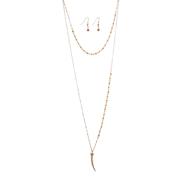 "Gold tone layering necklace set with topaz glass beads and a 1 3/4"" horn pendant. Approximately 30"" in length."