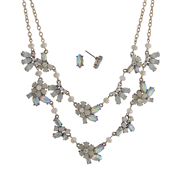 "Worn gold tone layering necklace set displaying ivory flowers with iridescent rhinestone accents. Approximately 20"" in length."