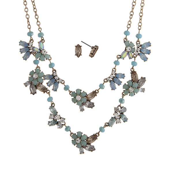 "Worn gold tone layering necklace set displaying mint and blue flowers with clear rhinestone accents. Approximately 20"" in length."