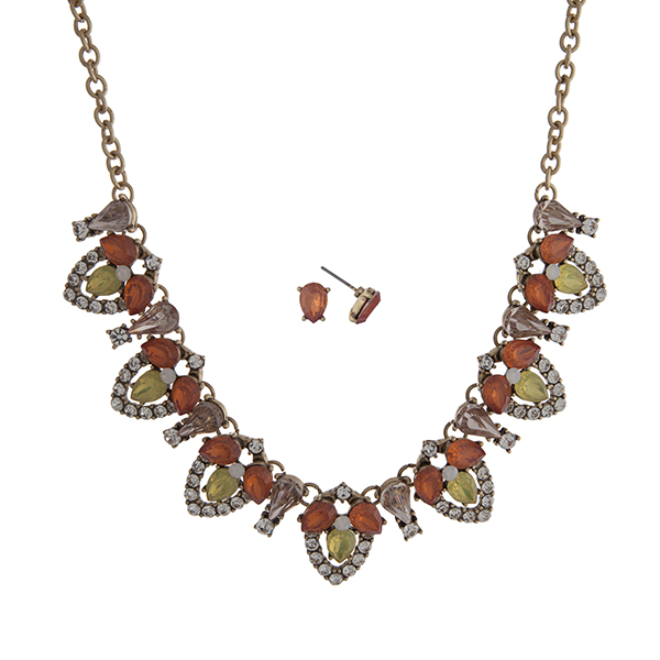 """Worn gold tone necklace set displaying coral and yellow teardrop shape cabochons with clear rhinestone accents. Approximately 17"""" in length."""