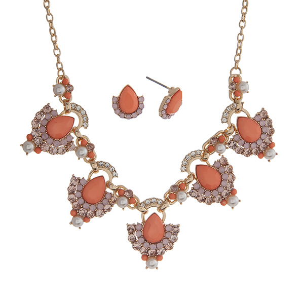 "Gold tone necklace set displaying coral teardrop shape cabochons surrounded by rhinestones and faux pearl accents. Approximately 18"" in length."