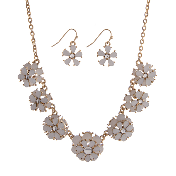 """Gold tone necklace set displaying white layered flowers. Approximately 15"""" in length."""