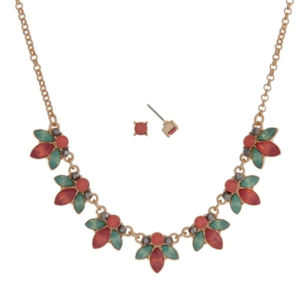 "Gold tone necklace set with mint green and coral flowers and rhinestone accents. Approximately 16"" in length."