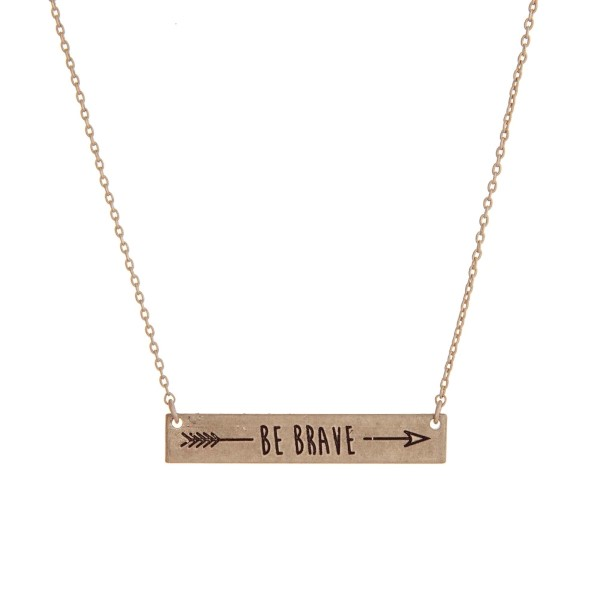 """Dainty gold tone necklace with a bar focal stamped with """"Be Brave"""" and an arrow. Approximately 16"""" in length."""