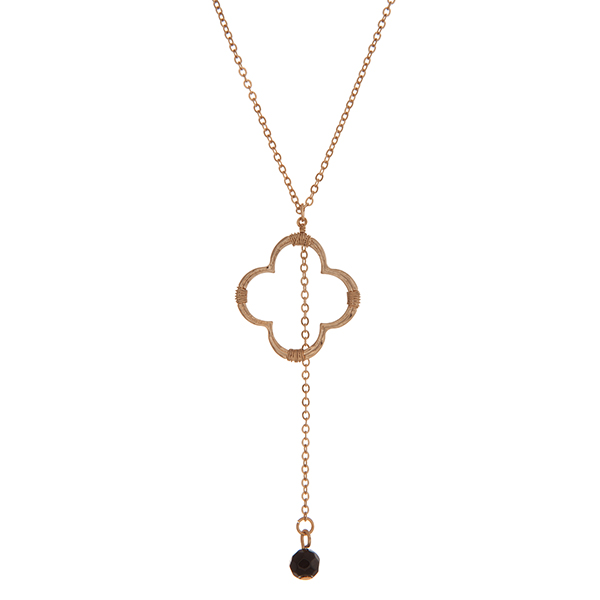 "Dainty gold tone necklace with a quatrefoil pendant and black faceted bead charm. Approximately 18"" in length."