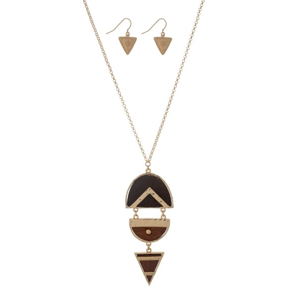 """Gold tone necklace set with a wooden geometric pendant. Approximately 32"""" in length."""