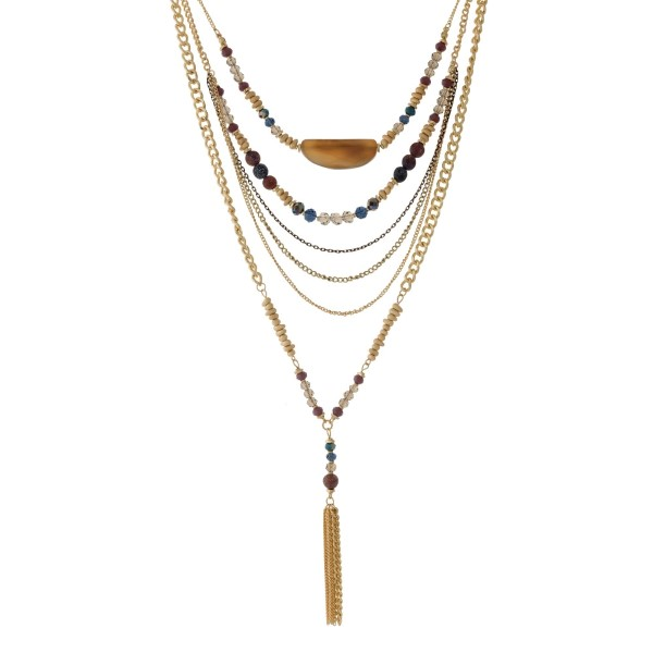 """Gold tone multi-layer necklace with gray, purple, and turquoise beads, a brown stone, and a chain tassel. Approximately 32"""" in length."""
