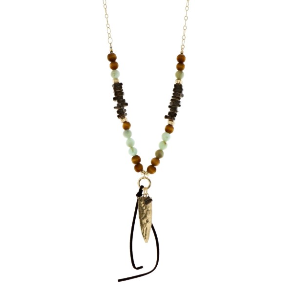 """Gold tone necklace with wooden and mint green beads and an arrowhead pendant. Approximately 32"""" in length."""