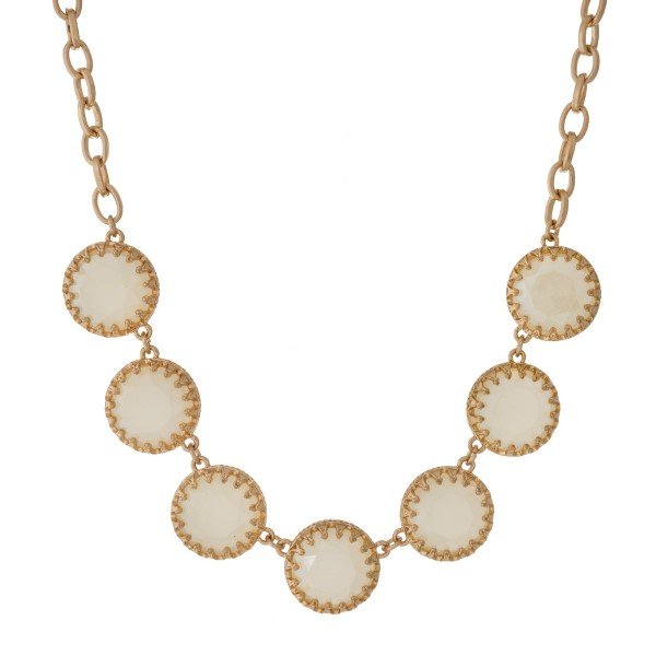 "Gold tone necklace with shimmering ivory epoxy circle stones. Approximately 16"" in length."