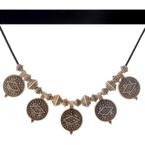 """Black velvet double layer choker necklace with hammered gold tone Aztec circles. Approximately 14"""" in length."""