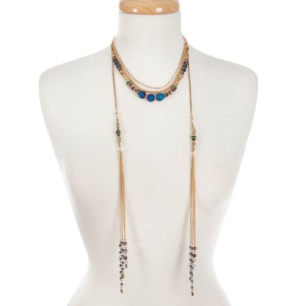 """Gold tone multi layer necklace with bronze and blue beads. Approximately 16"""" in length."""