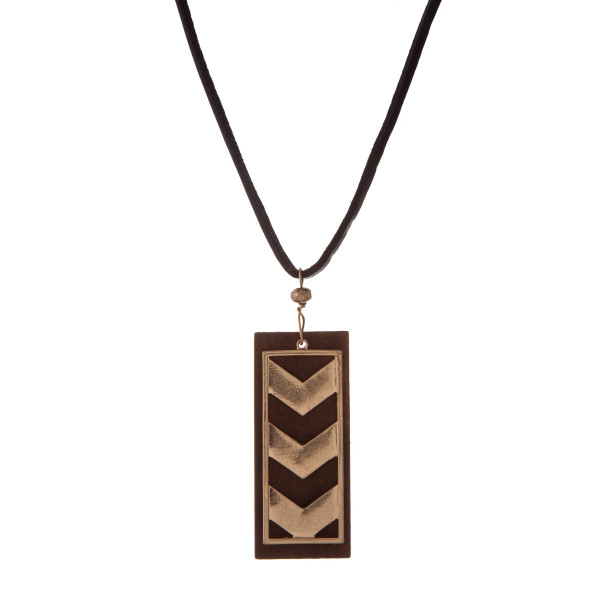 """Brown leather cord necklace with a wooden and gold tone arrow pendant. Approximately 32"""" in length."""