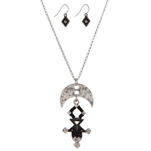 """Silver tone necklace set with an Aztec pendant and matching fishhook earrings. Approximately 32"""" in length."""