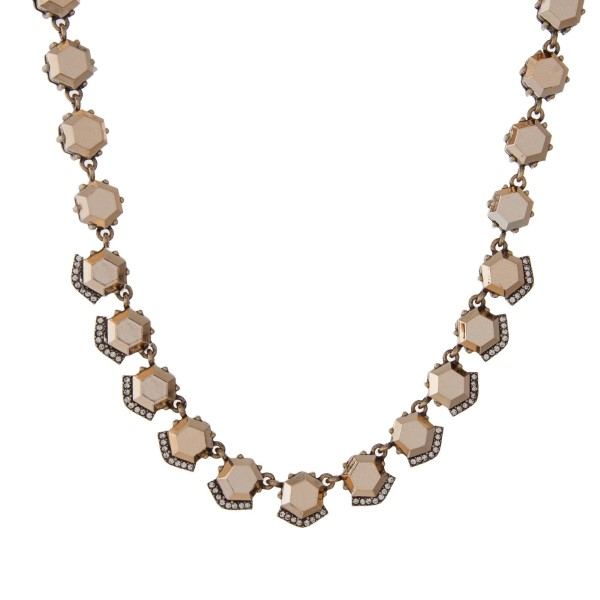 "Gold tone necklace with bronze hexagonal stones. Approximately 16"" in length."