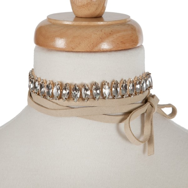 "Tan suede wrap necklace with a gold tone choker displaying clear rhinestones. Approximately 70"" in length."