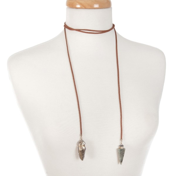 """Brown faux suede wrap necklace with hammered gold tone arrowhead and gray labradorite arrowhead pendant. Approximately 55"""" in length."""