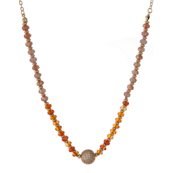 "Gold tone necklace with topaz and carnelian faceted, glass beads and a pave rhinestone focal. Approximately 16"" in length. Handmade in the USA."