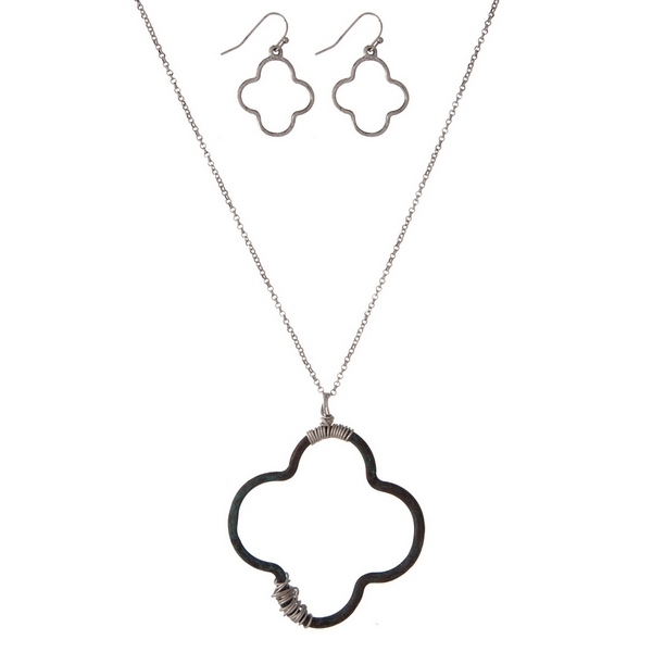 "Silver tone necklace set with a patina quatrefoil pendant and matching fishhook earrings. Approximately 32"" in length."