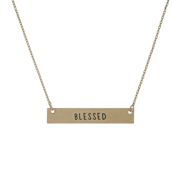 "Dainty gold tone necklace with a bar focal, stamped with ""Blessed."" Approximately 16"" in length."