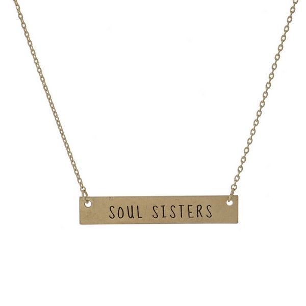 "Dainty gold tone necklace with a bar focal, stamped with ""Soul Sisters."" Approximately 16"" in length."