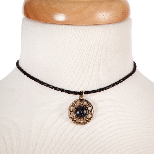 """Black braided cord choker with a gold tone circle pendant, accented with a black stone. Approximately 12"""" in length."""