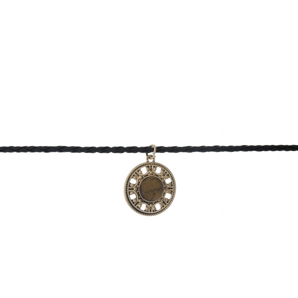 "Black braided cord choker with a gold tone circle pendant, accented with a brown stone. Approximately 12"" in length."