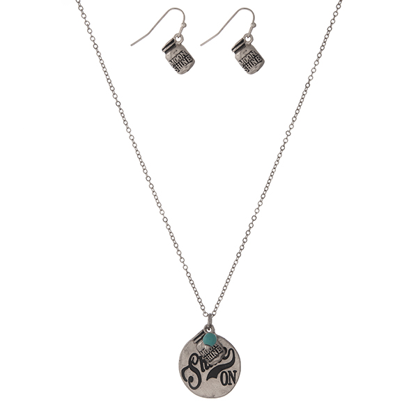 """Dainty silver tone necklace set with a circle pendant stamped with """"Shine On"""" and accented with a turquoise bead and matching fishhook earrings. Approximately 16"""" in length."""
