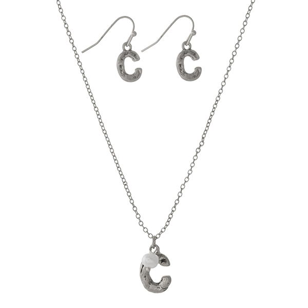 "Burnished silver tone necklace set with a block 'C' initial, accented by a freshwater peal bead and matching fishhook earrings. Approximately 16"" in length."