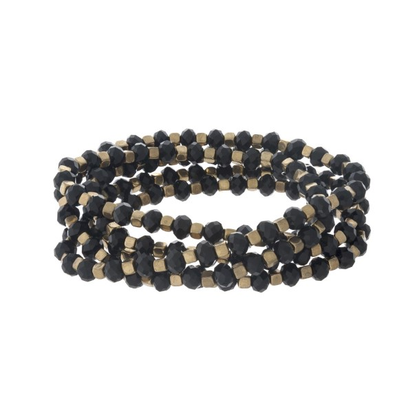 """Black and gold tone beaded bracelet that can also be worn as a necklace. Approximately 38"""" in length."""