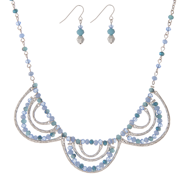 "Silver tone necklace set with turquoise and blue beads, a scalloped design, and matching fishhook earrings. Approximately 16"" in length."