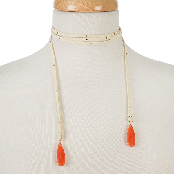 "Tan faux suede wrap necklace with gold tone studs and coral stones on the ends. Approximately 64"" in length."