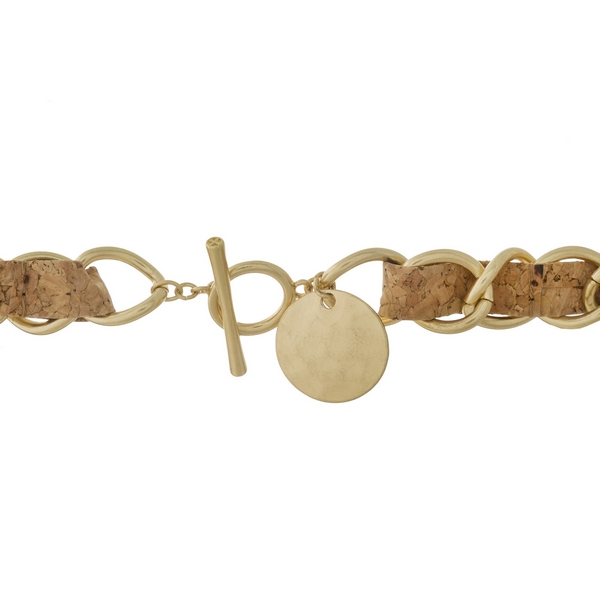 """Gold tone and cork necklace with a toggle closure. Approximately 13"""" in length."""