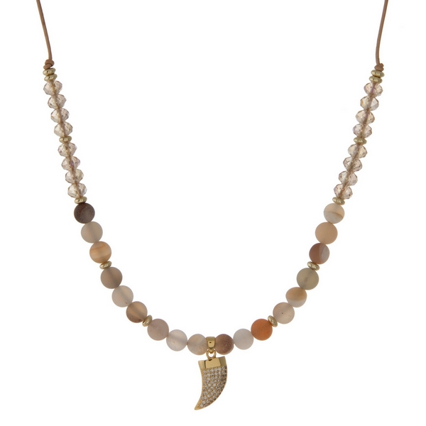 "Brown cord necklace with botswana natural stone beads, topaz faceted beads and a gold tone horn pendant. Approximately 16"" in length. Handmade in the USA."