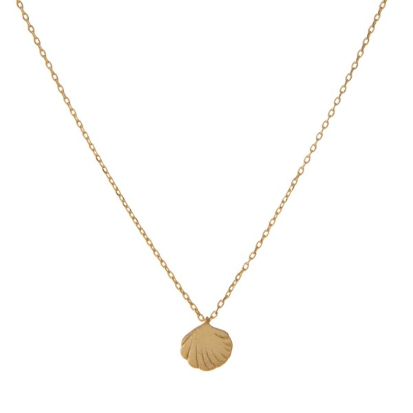"Dainty gold tone necklace with a seashell pendant. Approximately 14"" in length."