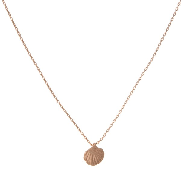 "Dainty rose gold tone necklace with a seashell pendant. Approximately 14"" in length."