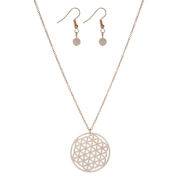 """Gold tone necklace set with a white, laser cut, circle pendant and matching fishhook earrings. Approximately 16"""" in length."""