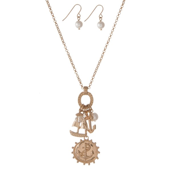 "Gold tone necklace set with anchor and sailboat charms and matching fishhook earrings. Approximately 18"" in length."
